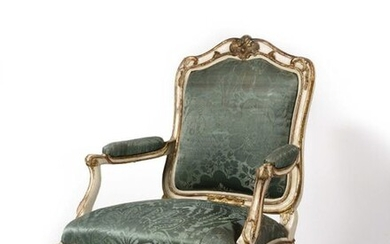 Large armchair with painted and gilded wooden frame, with flat, moving backrest decorated with cartouches, staples and foliage, resting on arched legs finished with volutes. Louis XV period H : 105 cm, L : 76 cm