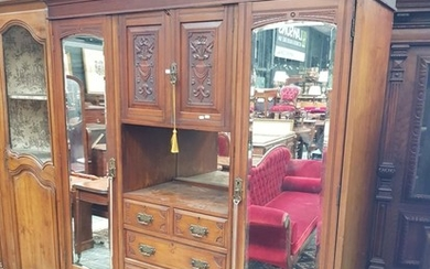 Late Victorian Walnut Wardrobe, with two carved panel doors, open shelf and five drawers, flanked by long mirror doors