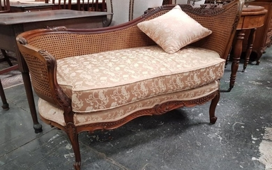 Louis XV Style Carved Walnut Chaise or Daybed, with caned back and yellow upholstered seat, on cabriole legs