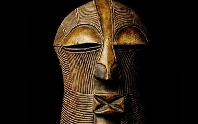 "MASK TYPE ""KIFWEBE"" feminine, the whole surface covered with striations arranged in harmony and regularity. Wood, shiny patina of use. Songyé, Democratic Republic of Congo"