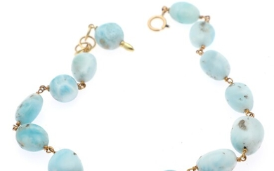 Natascha Trolle: A larimar bracelet set with numerous polished larimar beads, mounted in 18k gold. L. 21–22 cm.