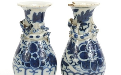 Pair of Chinese blue and white porcelain vases with relief d...