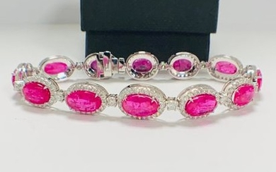 Platinum Ruby and Diamond bracelet featuring, 12 oval...