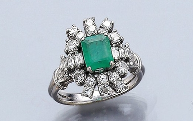 Platinum ring with diamonds and emerald ,...