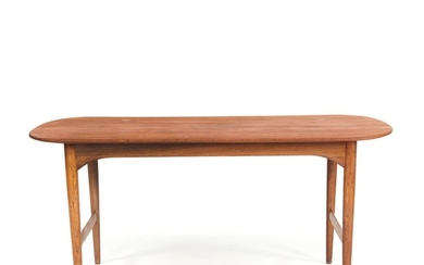 Torsten Johansson: Rare coffee table with legs of Brazilian rosewood, top of solid teak. Made by cabinetmaker A.J. Iversen.