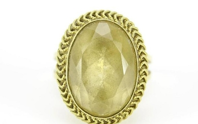 Unmarked gold citrine ring with rope design setting,
