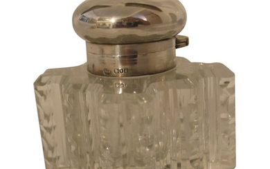 1 Crystal inkwell with silver stopper.