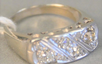 14k white gold ring set with eight diamonds, 4.4 gr.