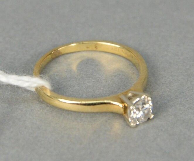 18 karat yellow gold and diamond engagement ring with