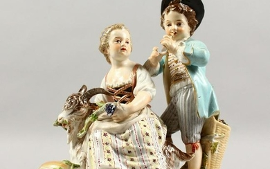 A 19TH CENTURY MEISSEN PORCELAIN GROUP OF A BOY AND