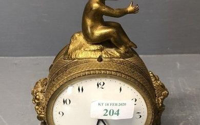 A C19th Ormolu clock with cherub finial and white face and b...