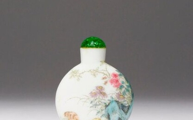 A CHINESE FAMILLE ROSE ENAMELLED GLASS SNUFF BOTTLE FOUR CHARACTER QIANLONG MARK AND PROBABLY OF THE PERIOD The circular body raised on a short oval foot and surmounted by a cylindrical neck, painted to each side with chicks amidst rocks and various...