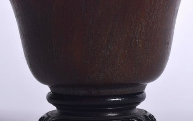 A CHINESE HORN BOWL ON HARDWOOD STAND, formed with a