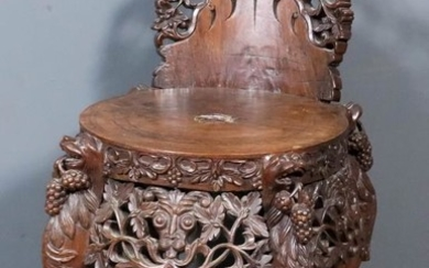 A Chinese Carved Wood Low Back Chair, the whole...