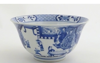 A Chinese blue and white footed bowl with a flared rim, deco...