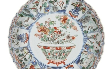 A Chinese porcelain moulded dish, Kangxi period, painted in famille...