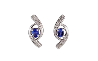 A PAIR OF DIAMOND AND TANZANITE EARRINGS, mounted in white g...