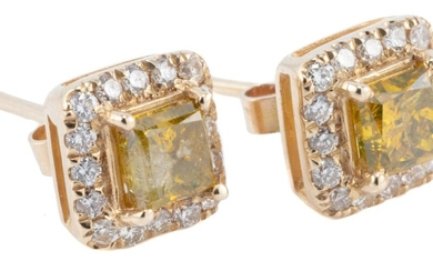 A PAIR OF YELLOW AND WHITE DIAMOND STUD EARRINGS; each a square cluster centring a treated yellow princess cut diamond surrounded by...