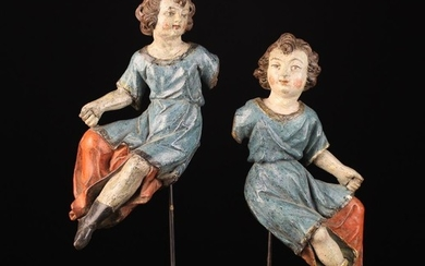 A Pair of 16th/Early 17th Century Carved Wooden Angels with polychrome paintwork. The figures depict