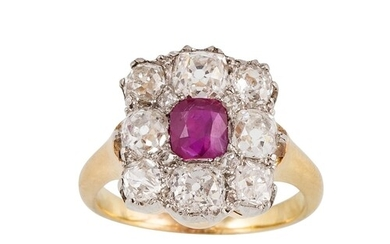 A RUBY AND DIAMOND CLUSTER RING, the oval ruby to an old cut...