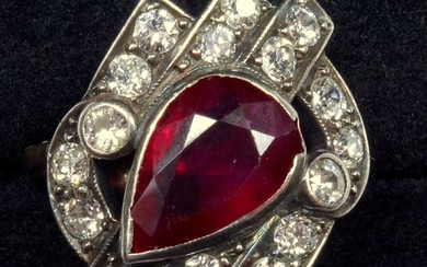 A RUBY AND DIAMOND DRESS RING, PEAR CUT RUBY WEIGHING AN EST...