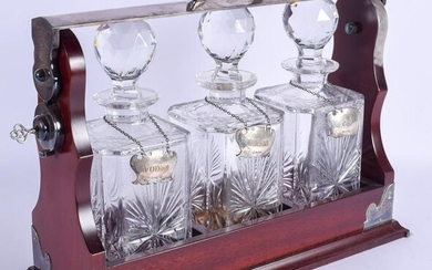 A SILVER PLATED AND SILVER DECANTER SET within a