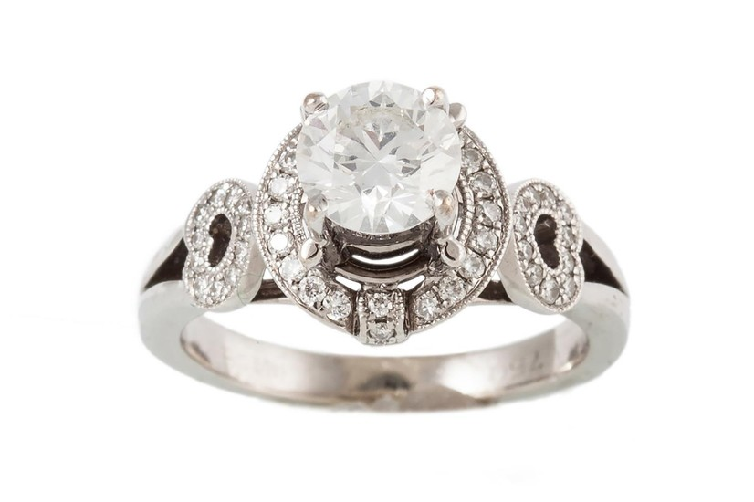 A SOLITAIRE DIAMOND RING, the brilliant cut diamond to a dia...