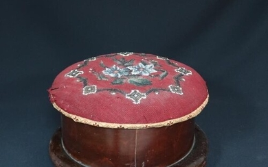 A Victorian circular needlepoint upholstered footstool on bu...