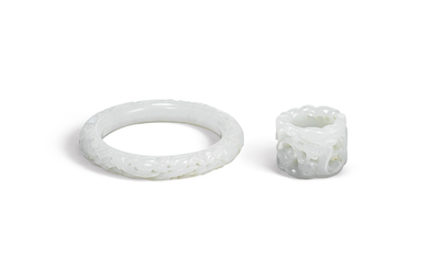 A WHITE JADE OPENWORK BANGLE AND A WHITE JADE ARCHER'S RING, QING DYNASTY (1644-1911)