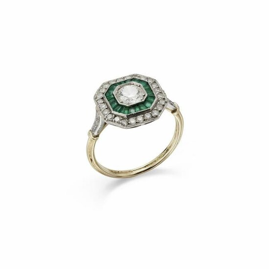 A diamond and emerald target cluster ring