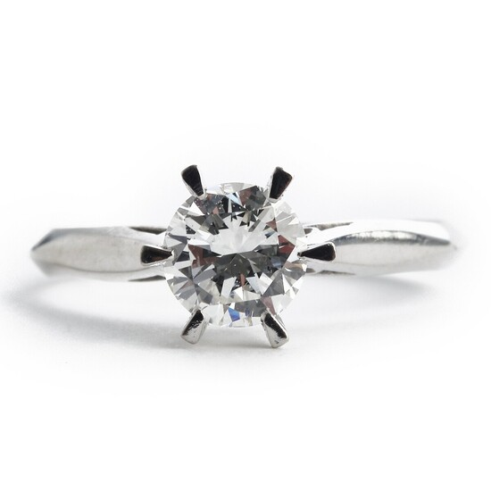 A diamond solitaire ring set with a brilliant-cut diamond weighing app. 0.94 ct., mounted in 14k white gold. Colour H. Clarity SI. Size 57.5.