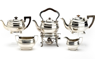 A five-piece tea service with burner and stand