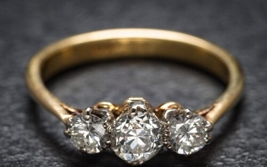 A gold, platinum and diamond three-stone ring: with central ...