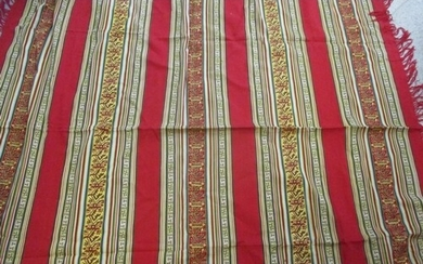 A mid to late 20th century Eastern throw in rich red and gol...