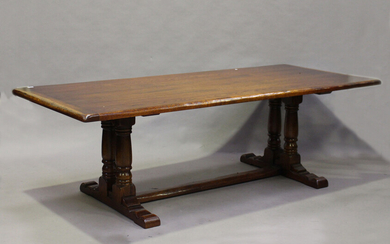 A modern Jacobean Revival oak refectory dining table by the Royal Oak Furniture Company, the seven-p