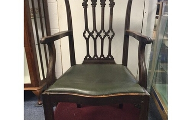 A pair of Chippendale style elbow chairs, with carved and pi...