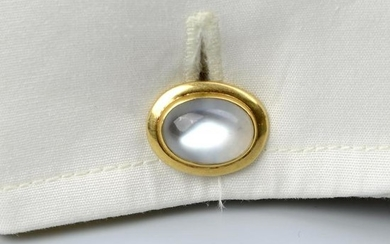 A pair of Edwardian 18ct gold moonstone cufflinks.