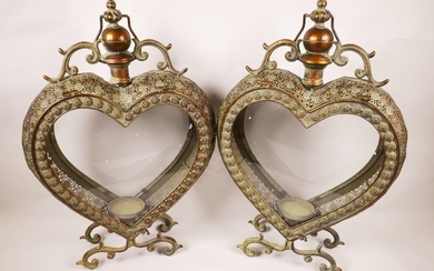 A pair of metal and glass, heart shaped garden candle lanter...