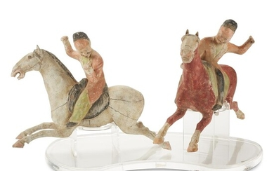 A pair of painted pottery Polo Players Tang dynasty...