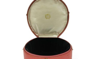 A pink leather tiara case by Cartier, with...