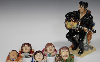 A prototype Kevin Francis model of Elvis Presley, modelled seated playing his guitar, painted in puc