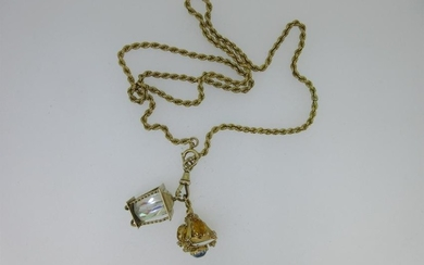 A rope link chain with two charms,