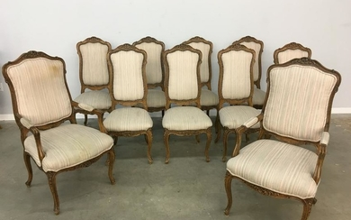 A set of ten French Provincial style dining chairs
