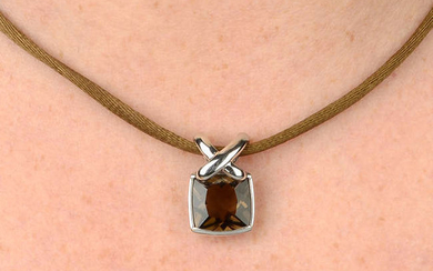 A smoky quartz 'Liens' pendant, with brown cord, by Chaumet.