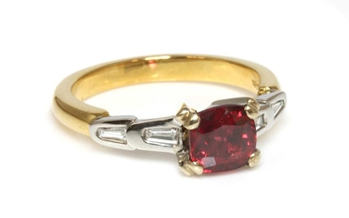 A two colour gold single stone red spinel ring