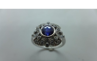 A very pretty 18ct white gold diamond and sapphire ring, the...