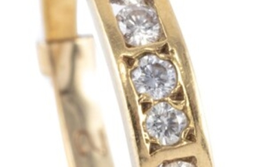 AN 18CT GOLD DIAMOND RING; channel and gypsy set with 8 round brilliant cut diamonds totalling approx. 0.25ct, size Q, wt. 2.63g.