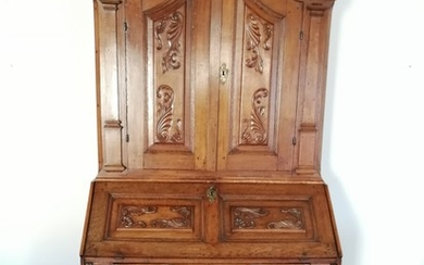 An 18th century baroque oak bureau. Two keys. H. 222. W. 114. D. 35/60 cm.