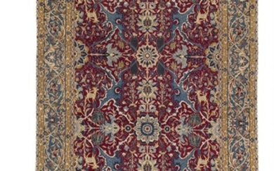 An Isfahan rug, Persia. Decorative all over design of palmettes, rosettes, entwined branches, flowers, foliage and animal motifs. Mid-20th century. 253×148.