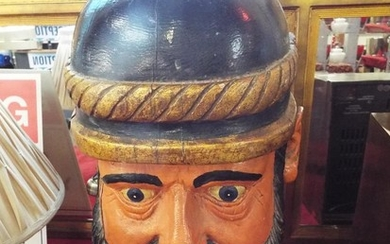 An early 20thC carved and hand painted wooden bust of a Germ...